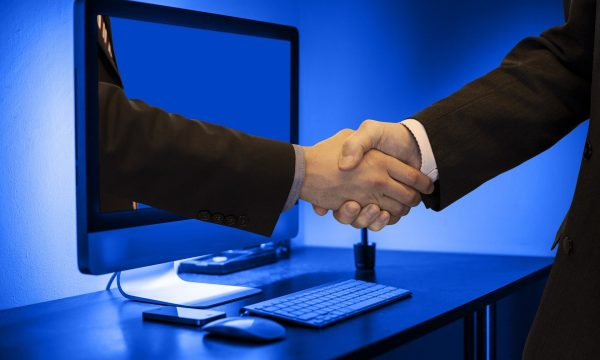 handshake-through-computer-screen